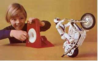 Looking on excitedly at the Evel Knievel Stunt Cycle