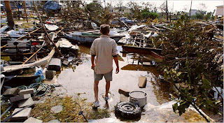 Christopher Cox amid the remnants of his in Galveston after Hurricane Ike