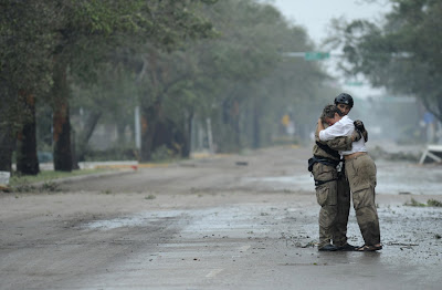 U.S. Air Force Pararescueman Staff Sgt. Lopaka Mounts receives a hug from a resident during search and rescue operations after Hurricane Ike in Galveston, Texas September 13, 2008