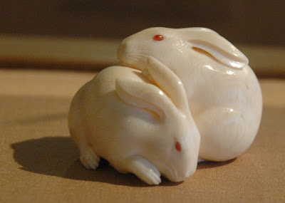 Kaigyokusai {Masatsugu}, Japan 1813-1892, pair of rabbit netsuke in ivory with inlays