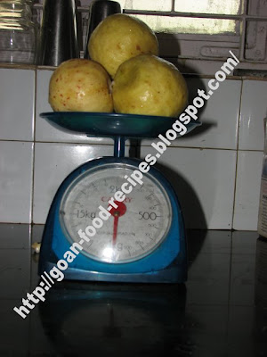 Guavas Being Weighed