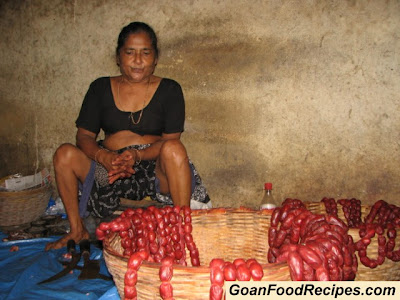 woman selling goa sausages