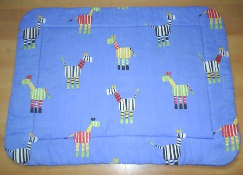 Cobertor reversible  0.80x1.00 aprox.