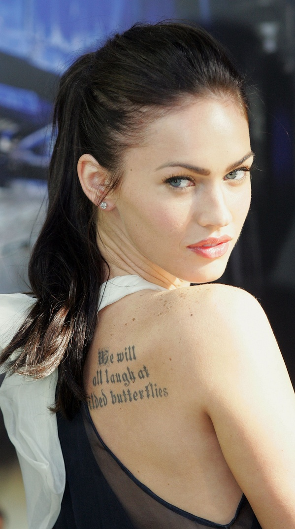 rib writing tattoos for girls