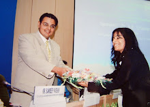 "Suchit Dave presented with bouquet at Seminar on ""Judicial Reforms"""