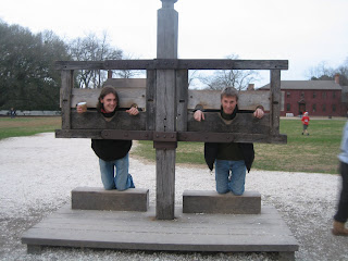 Image of men in stocks at Jamestown. Travel and other topics