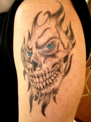 skull on fire tattoos, arm upper tattoo, popular tattoo style