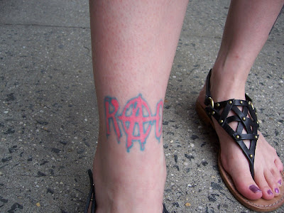 "at the bottom of the leg, she had the word ""Rad"" tattooed. Nebraska"
