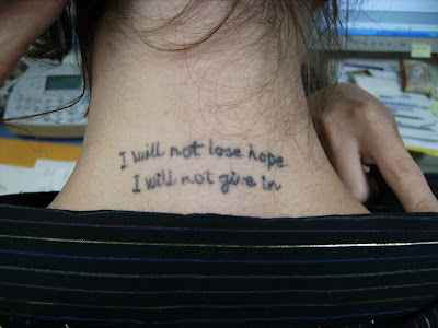 "Ashley has this tattoo on the back of her neck. The lines ""I will not lose"