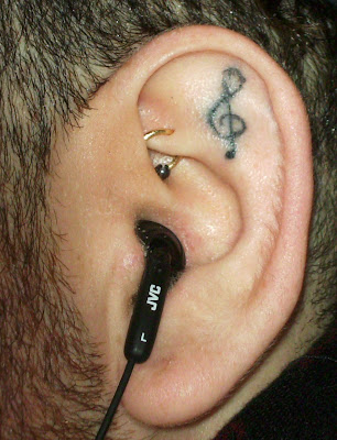 He had this musical symbol (the treble, or G Clef) tattooed in his left ear,