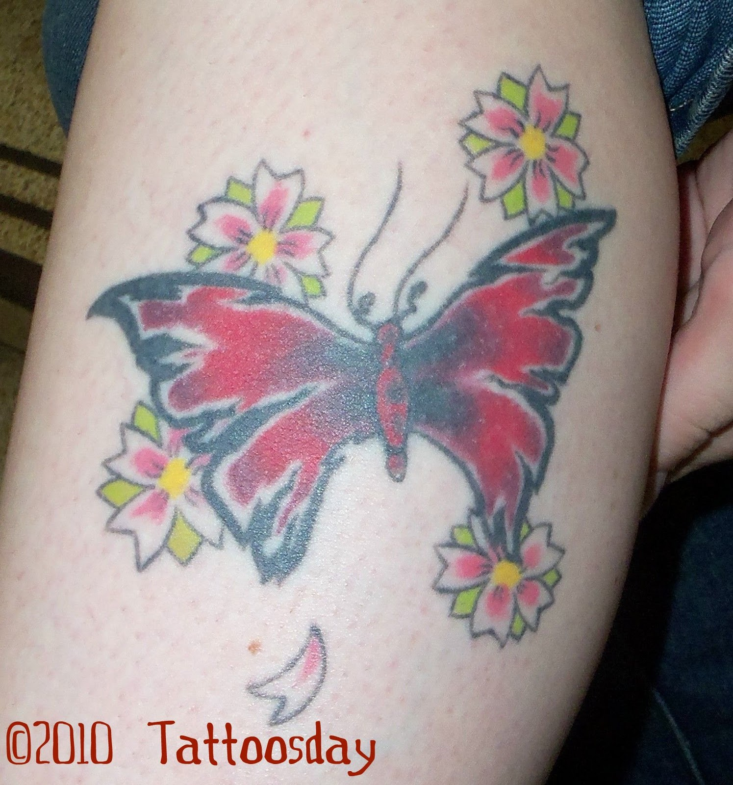 butterfly and hawaiian flower tattoos