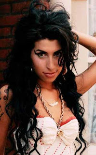 Singer Amy Winehouse duets with father