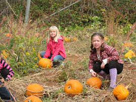 Addy and her friend Maddy at the pumpkin patch.
