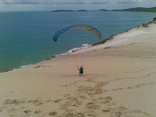 Local French dude, Guy, launches from Carlo Sand Blow, Rainbow Beach