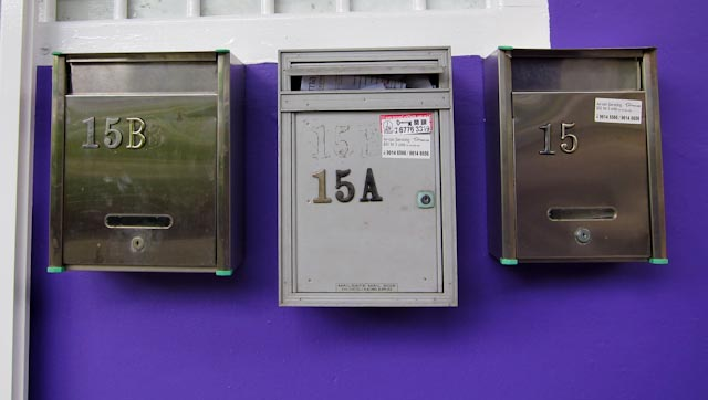 letter boxes. 3 letter boxes on a purple