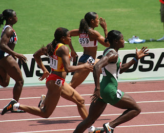 Women runners in the 100 meter dash.