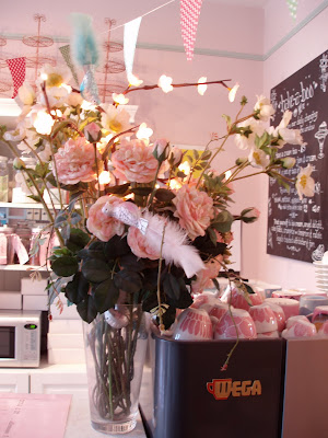 Bake-a-Boo West Hampstead interior bunting flowers Wega