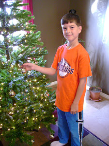 Logan adding some ornaments...