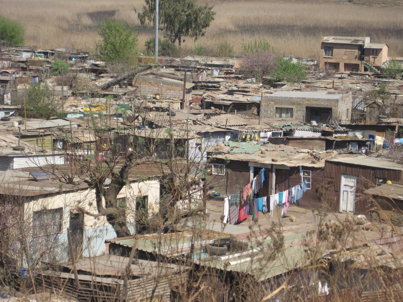 shanty towns Shanty town residents have run out of luck with the government as labour  minister dion foulkes told eyewitness news thursday that it is only.