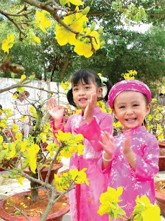 Southern spring with god apricot blossom, the children wear traditional orient robe