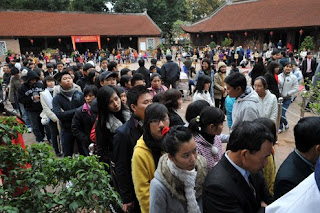 The first day of new year in Van Mieu (The first University in Vietnam)