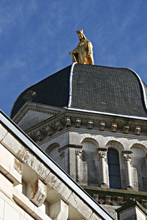 golden statue of Notre Dame on cupola
