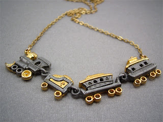 gold and silver train necklace