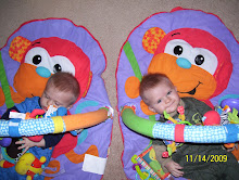 This is how the twins start out in their Merry Monkey Gyms...
