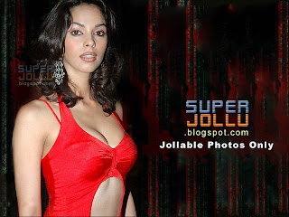 Malaika sherawat the most glamorous girl in bollywood india.  In a red sleeveless shirt