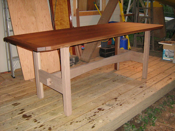 Custom table in walnut uncompleted oil finish.
