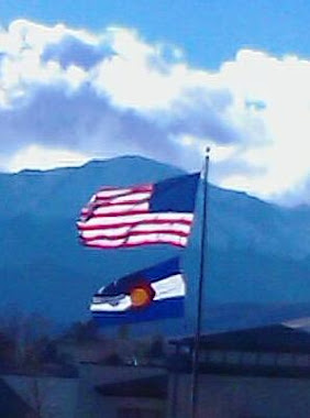 Colorado flag in front of Pikes Peak