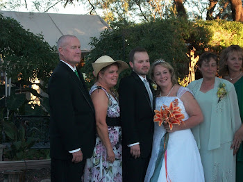 Bride and groom, mothers and Dad