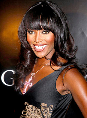 Naomi Campbell black curly long haircuts with blunt bangs