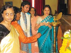 Sucharita R. Hegde lighting the lamp