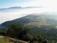 Al fons, el Matagalls, el Pla de la Calma i les Agudes. A primer terme el Pla de la Garga amb unes granges al Coll de Taló