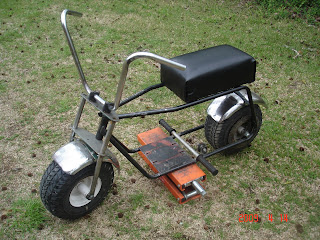 this is a harrison wildcat mini bike frame that is for salehas new wheel bearingsnew seatno brakeno kick standfront fork is bentbut straight forward