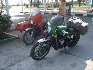 Elvis Cafe Racer Beside Ukrainian Relic with Sidecar