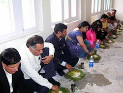 The Union Minister for Steel, Chemicals and Fertilisers, Mr Ram Vilas Paswan, enjoys Himachali food