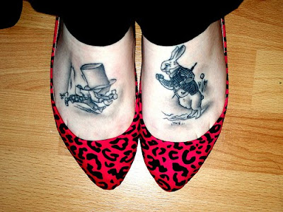 Check out this enormous gallery of Alice in Wonderland tattoos.