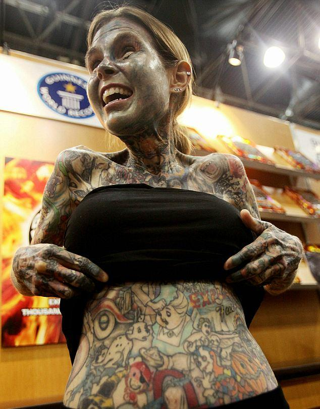 The world's most Craziest tattooed woman flaunts her body art