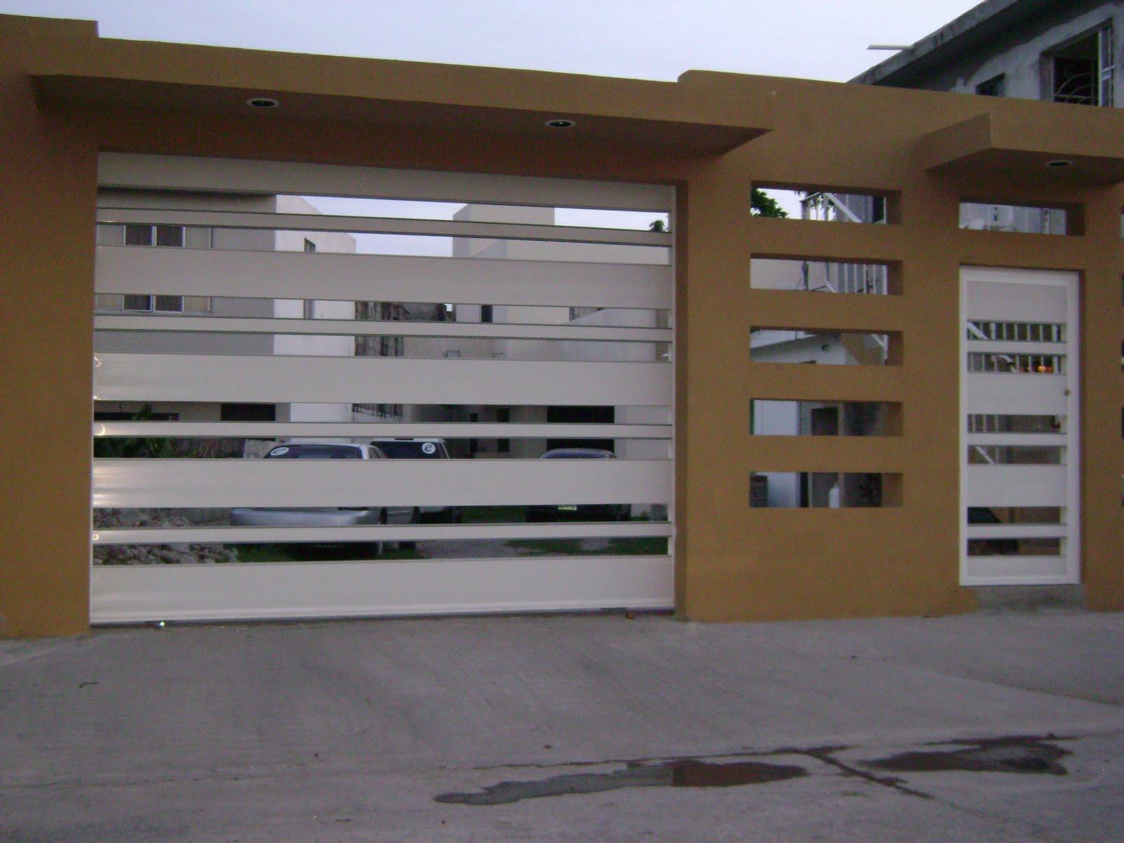 Technology doors puertas y portones for Modelos de portones de hierro