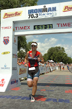 Tracy Butler finishing Ironman 70.3 Racine