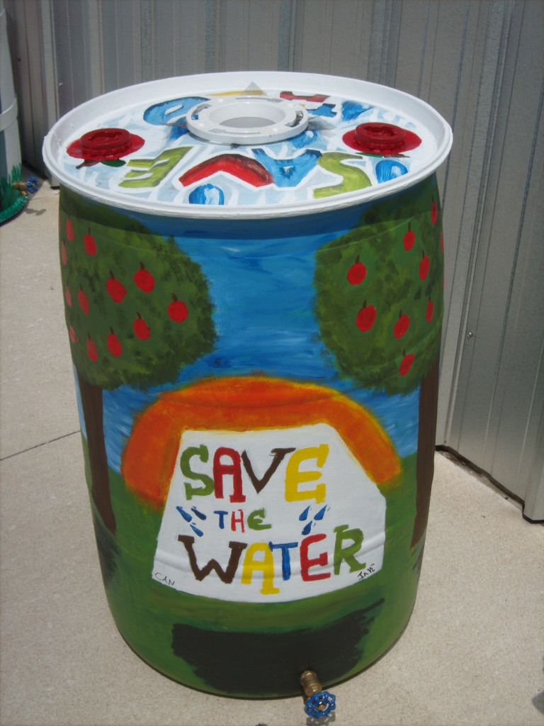 You can even make your rain barrel purty, like this guy!