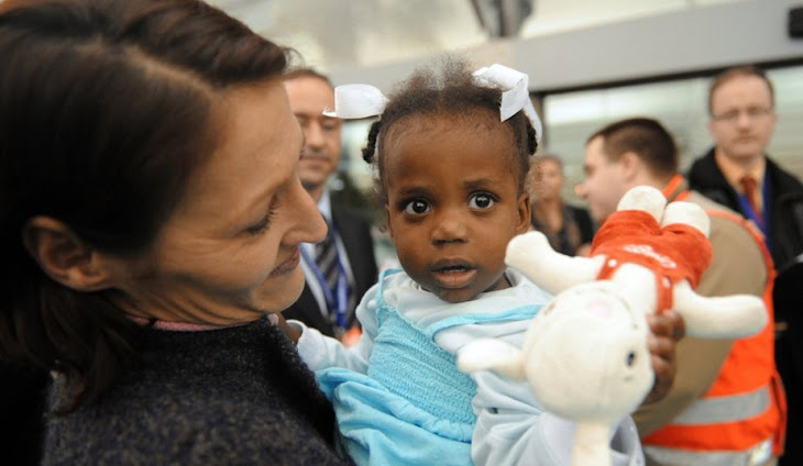 French Families Adopt Haitian Children:  Arrival in France