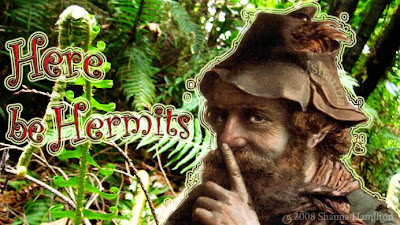 [Postcard Art montage of my garden ferns and a hobo knowingly touching his nose with caption here be hermits done in 1970 style]