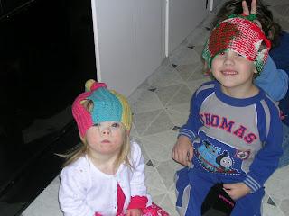 Gilly & Harry wearing tea cozies.