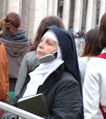 Pious nun gazes at St Peter's Basilica