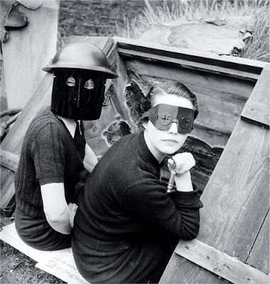 Lee Miller, Women with Fire Masks, Downshire Hill, London, 1941, black-and-white photograph