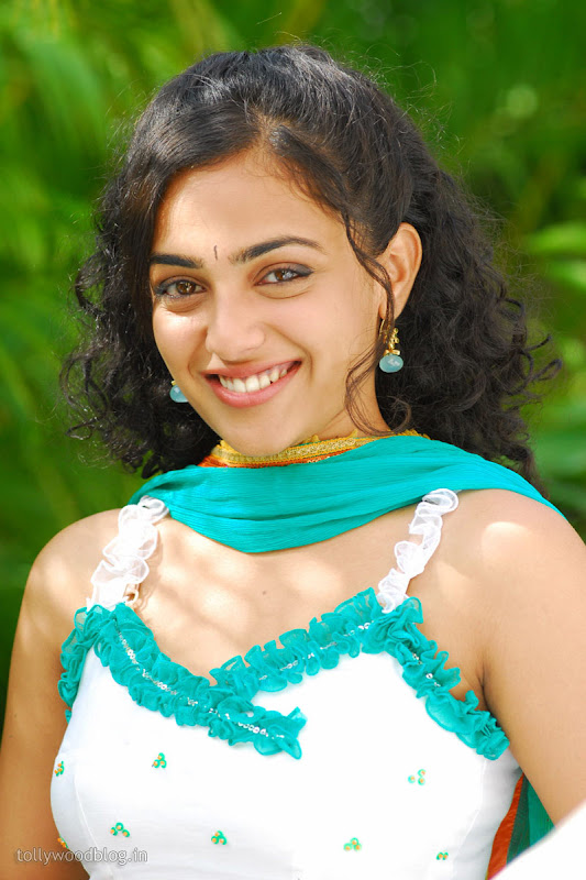 Nitya Menon Cute Looking Stills from Ala Modalaindhi Telugu Movie Photoshoot images