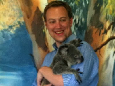 John Metz gets cuddly with a Cairns koala.